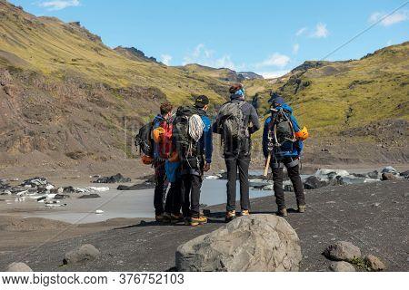 Tourists Hiking At Solheimajokull Glacier, Iceland
