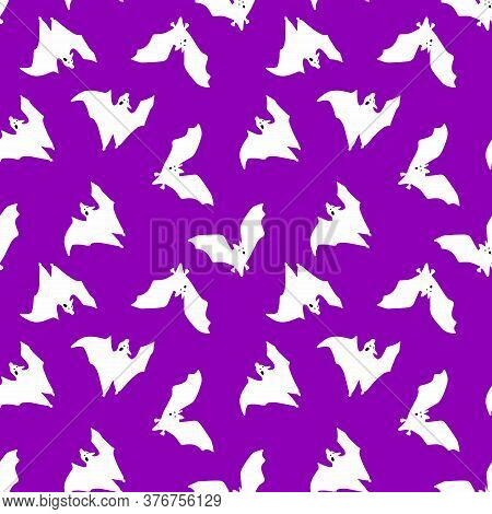 Seamless Pattern Of Bats. White Bats On A Black Background. Design For Halloween. Vector Illustratio