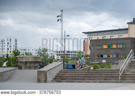 Malmo, Sweden - July 12, 2020: People Gather In The Skatepark In West Harbor For Skateboarding. This