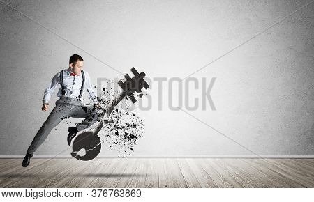 Determined Businessman Jumping And Breaking With Kick Stone Key Figure