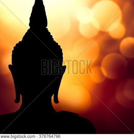 Buddha face silhouette against magic lights