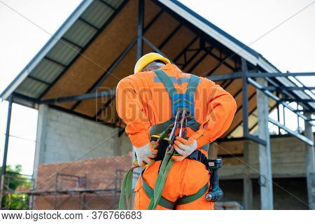 Engineer Wearing Safety Harness And Safety Line Working At High Place,practices Of Occupational Safe