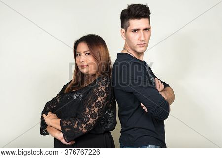 Portrait Of Overweight Asian Businesswoman And Young Man As Couple Together