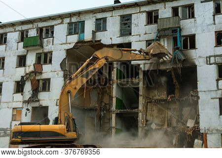 Demolition Of A Five-story Apartment Building Recognized As Emergency Housing, Excavator Bucket Dest