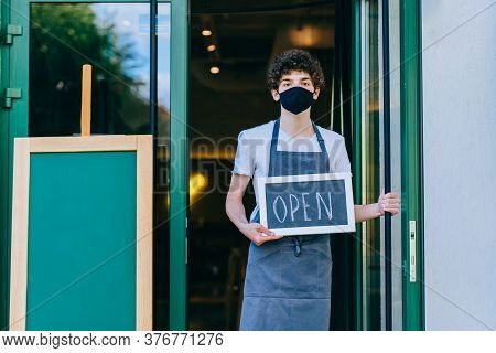 Business Owner Attractive Young Asian Man In Apron Hanging Were Open Sign On Front Door Welcoming Cl