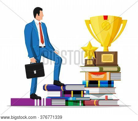 Businessman With Trophy On Stack Of Books. Business Man With Medal. Education And Study. Business Su