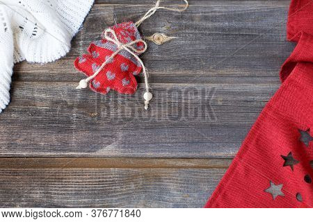 New Year Flat Lay: Christmas Linen Tree With Hearts, White Woolen Plaid And Red Tablecloth With Star