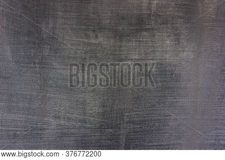 Gray Cement Plaster With Sanding Marks And Scratches On The Wall. Background For Design.