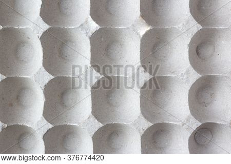 Background Container With Cells Of Pressed Paper For Laying Eggs. Paper Packaging For Eggs With Cell