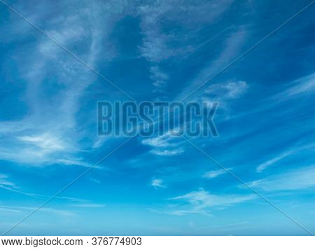 Blue Sky With White Clouds Background. Clear Sunny Day, With Scattered, Beautiful Clouds In A Clear