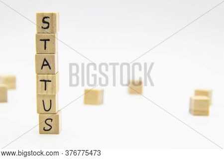 A Word Status Written On The Wood Cubes. Status Lettering Made Of Wooden Cubes Isolated On White