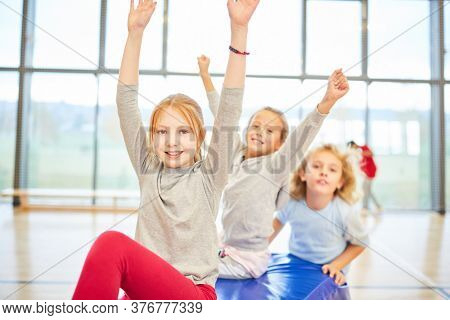 Group of kids of elementary school in the gym during a gym exercise