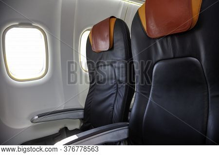 A Seat On The Plane. Empty Cabin Of The Plane. Soft Seats For Passengers, Portholes. Inside A Passen