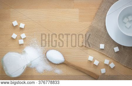White Sugar And Sugar Cubes In Wood Spoon On Wooden Background With Copy Space,coffee Mug With Sugar