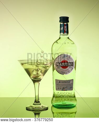 Martini Bianco. A Bottle Of Vermouth Martini With A Glass Of Close-up Logo On A Colored Background.