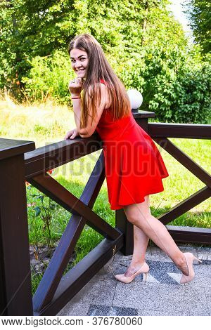 Pretty Girl Woman Brunette With Long Hair And Red Dress, Influencer, Fashion Blogger Photoshoot Outd