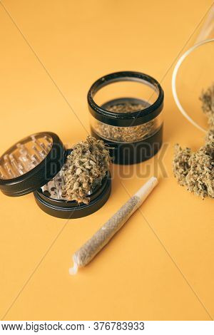 The Pot Leaves On Buds. Cannabis Nature Bud. Sativa Thc Cbd. Marijuana Weed Bud And Grinder. Joint W