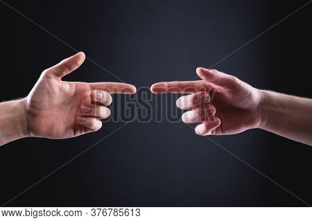 Two Mens Hands Point At Each Other With Index Fingers. The Concept Of Mutual Understanding Between M