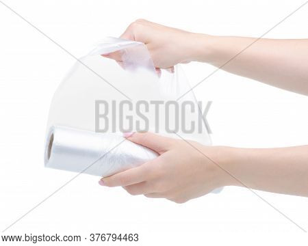 Roll Of Disposable Bags In Hand On White Background Isolation