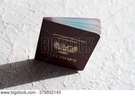 Passport Of The Donetsk People's Republic On A White Crumpled Background. The Inscription In Russian
