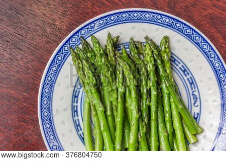 Green Asparagus Served On A White Plate