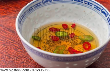 Traditional Spicy Asian Dipping Sauce With Sesame Oil And Hot Peppers