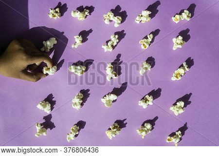Popcorn Arranged Neatly On A Colorful Background\nconceptual Of Obsessive Compulsive Disorder. Pop A