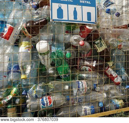 Trash Container With Empty Plastic Bottles From Pepsi, Sprite, Schveppes And From Water And Dairy Pr
