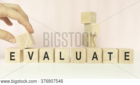 Evaluation Word Concept On Cubes On A Light Background