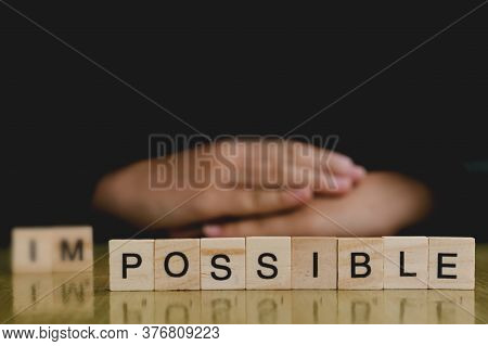Hand Change Wooden Cube With Word Impossible To Possible, Change Yourself Concept