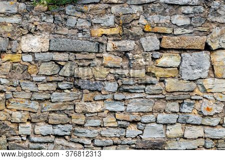 Texture Of Masonry. Old Stone Wall In The Building