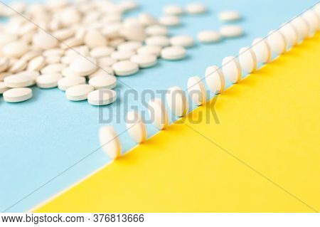 Abstract Yellow-blue Background, A Scattering Of Pills In A Row Stand Like Dominoes.healthcare, Medi