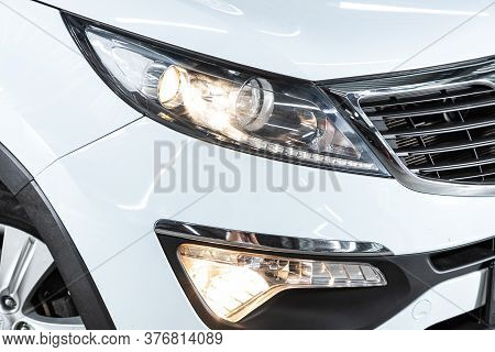 Novosibirsk/ Russia -  June 30 2020: Kia Sportage, Glowing Headlight Of A Modern Car Close-up