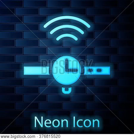 Glowing Neon Smartwatch Icon Isolated On Brick Wall Background. Internet Of Things Concept With Wire