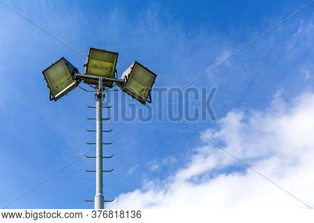 Reflector Light For Playground On Blue Sky Background. Halogen Light On Metal Pole. Stadium Lights R