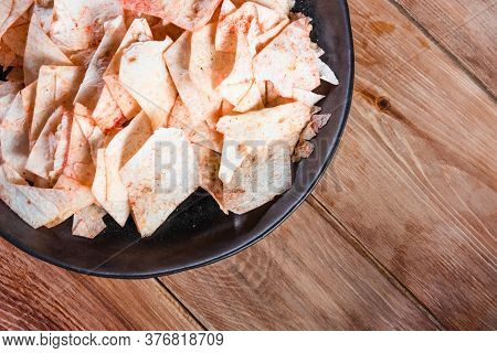 Potato Chips In A Plate Next To Ketchup On A Wooden Table. The Concept Of Not Healthy Food, Extra Co