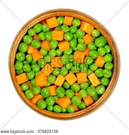 Green Peas And Carrot Cubes In Wooden Bowl. Mixed Vegetables. Seeds Of Pod Fruit Pisum Sativum And O