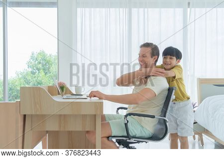 Smiling Business Blonde, Man. Freelance Working From Home Playing With His Son With Laptop Computer