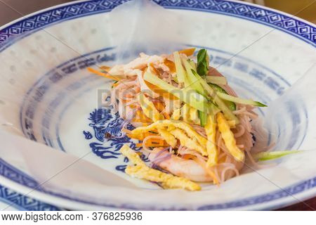 Making A Vietnamese Spring Roll With Rice Paper, Noodles, Prawns, Egg And Vegetables