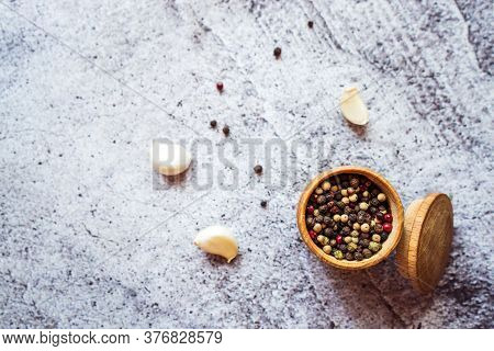 Spices From A Mixture Of Peppers And Garlic Are On The Table