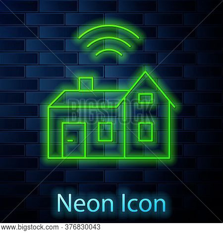 Glowing Neon Line Smart Home With Wireless Icon Isolated On Brick Wall Background. Remote Control. I