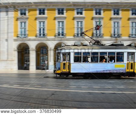 Vintage Yellow Tramway At The Commerce Square, In Lisbon, Portugal. Photography Made Using The Panni