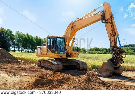 Construction Machinery Excavator On Construction Site For Earthworks Isolated