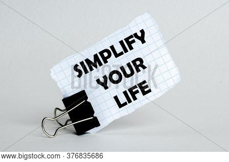 White Paper On The White Background With Text Simplify Your Life
