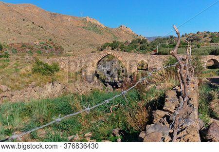 arabic arch of a bridge over the river Simeto, an example of ancient Sicilian architecture