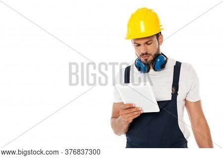 Workman In Hardhat And Ear Defenders Holding Digital Tablet Isolated On White