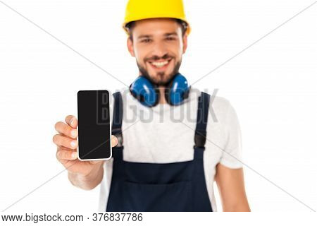 Selective Focus Of Smiling Workman Showing Smartphone With Blank Screen Isolated On White