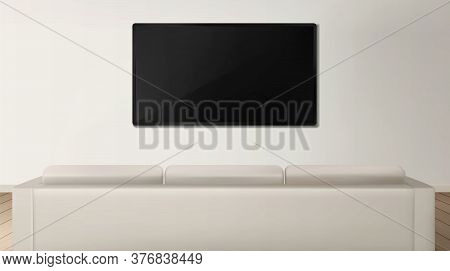 Sofa And Tv Back View In Living Room Interior, White Couch In Front Of Television Set Hanging On Wal