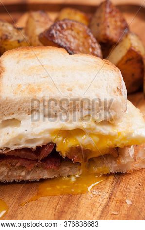 Eggs, Bacon And Cheve Cheese Breakfast Sandwich With Pan Fried Potatoes