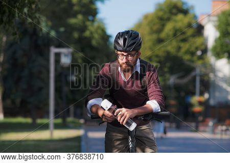 Male Bike Commuter With A Water Bottle. Safe Cycling In City, Bicycle Commuting, Active Urban Lifest